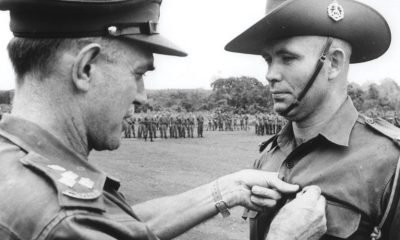 Bob Buick receives his Military Medal from Brigadier O.D. Jackson for his part in the battle